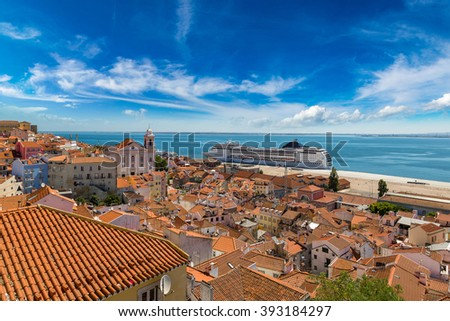 Big cruise ship is docked in Lisbon, Portugal in a beautiful summer day #393184297