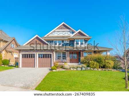 Big custom made luxury house with nicely landscaped front yard and driveway to garage in the suburb of Vancouver, Canada. #267409835