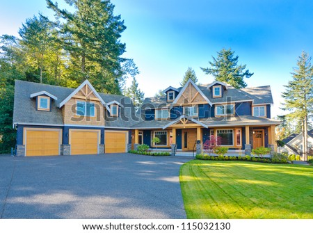 Big custom made triple doors garage luxury house in the suburbs of Vancouver, Canada.