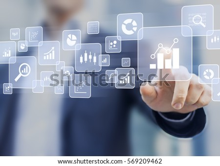 Big data analytics and business intelligence (BI) concept with chart and graph icons on a digital screen interface and a businessman in background