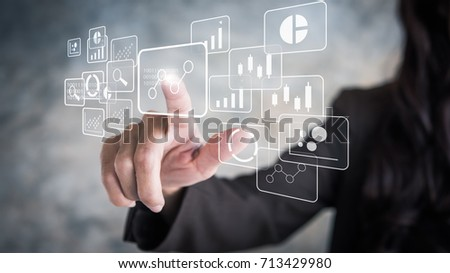 Big data analytics and business intelligence concept with chart and graph icons on a digital screen interface and a businessman in background