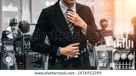 Big Data Technology for Business Finance Analytic Concept. Modern graphic interface shows massive information of business sale report, profit chart and stock market trends analysis on screen monitor. Foto stock ©