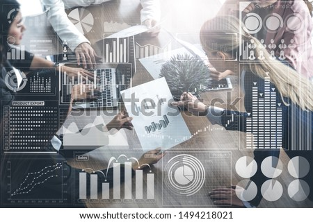 Big Data Technology for Business Finance Analytic Concept. Modern graphic interface shows massive information of business sale report, profit chart and stock market trends analysis on screen monitor.