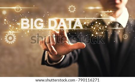 Big Data text with businessman on dark vintage background