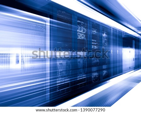 Big datacenter with control modules in server room motion blur 3d rendering #1390077290