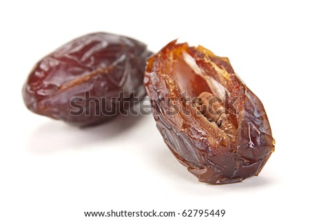 Big date dry fruit closeup on white background