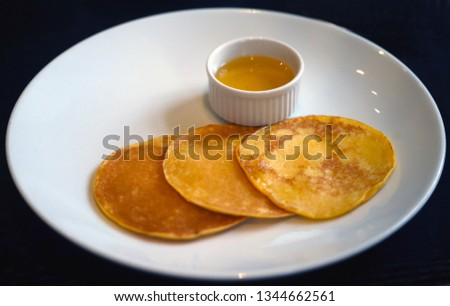 Big delicious pancake on a black background take a close-up picture