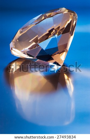 big diamond with reflection on blue