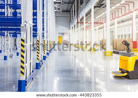 Big distribution warehouse with forklift for loading goods
