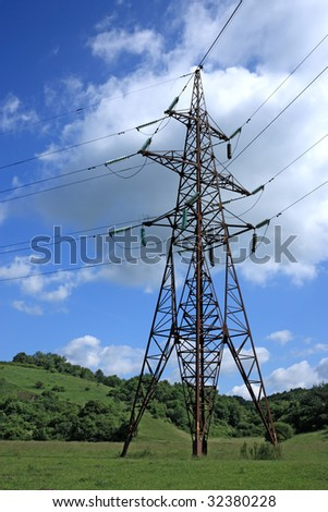 Big electrical tower on meadow