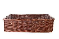 Big empty cane basket over white background