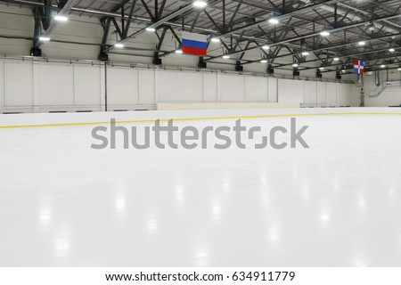 Big empty indoor new ice rick for competitions, hanging flags #634911779