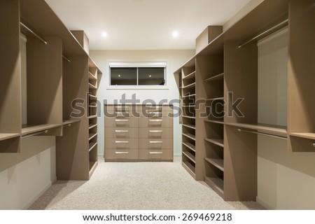 Big empty walk in wardrobe in luxurious house #269469218