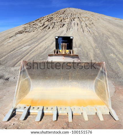 Big excavator in the mine. Environmental concept.