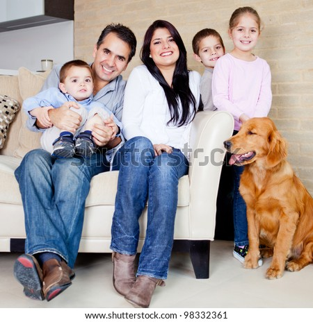 Big family at home with a dog all looking very happy stock photo