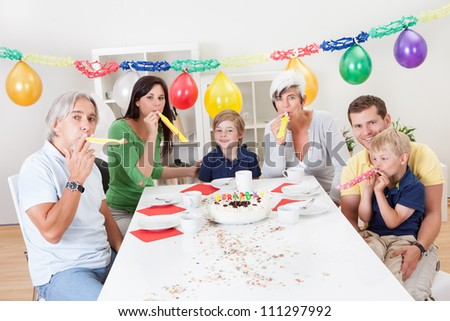 Big family celebrating birthday together at home