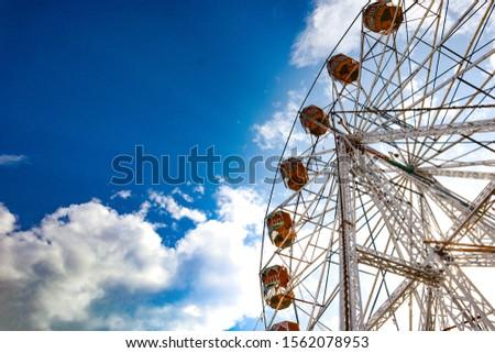 Big Ferris wheels in indian Fairs  With blue sky and cloud . A joy ride in pushkar Camel fair #1562078953