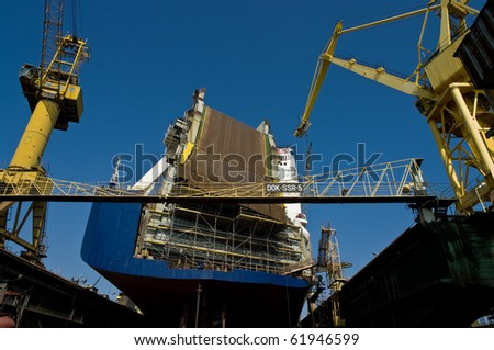 Big ferryboat in a dock during repairs.