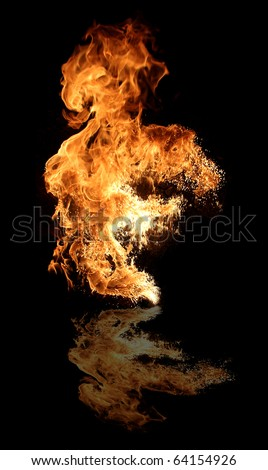 Big fire flame reflected on floor, isolated on black background