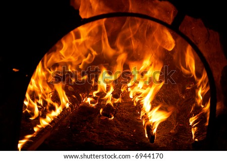 big flames from a fire burning inside an oven
