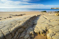 big flat stones on the beach in Portugal