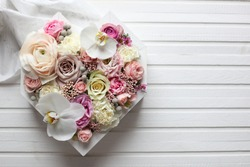 big flowers heart in pastel colors and white wood background