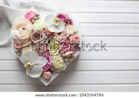 big flowers heart in pastel colors and white wood background #1043564596