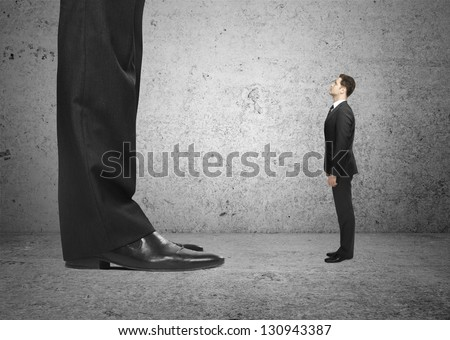 big foot and small  businessman