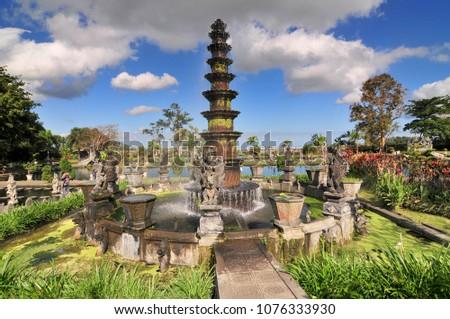 Big fountain in Royal water palace and pools Tirthagangga, Bali.  #1076333930