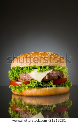 Big fresh delicious homemade hamburger with reflection