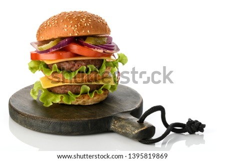 Big fresh tasty burger on wooden board  isolated on white background #1395819869