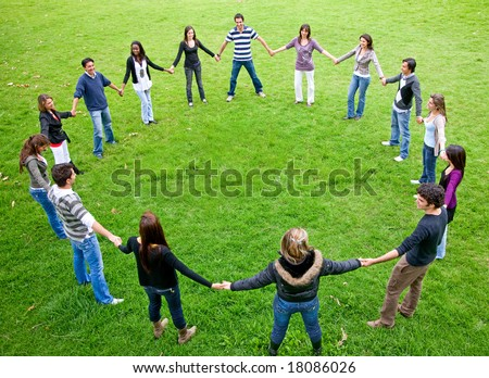 big friends doing a circle smiling and having fun in the park - stock photo