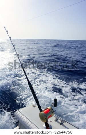 Big game boat saltwater fishing tourney with two rod and reel #32644750