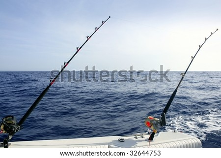 Big game boat saltwater fishing tourney with two rod and reel #32644753