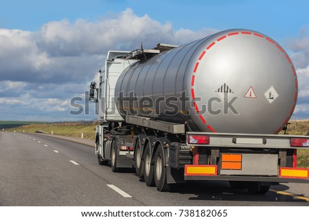 Big gas-tank truck goes on highway #738182065