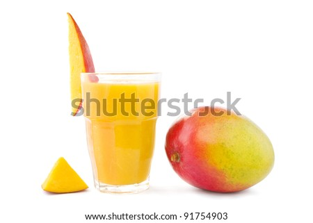 Big glass of mango smoothie with a mango