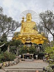 Big gold Buddha in Vietnam. Town - Dalat.