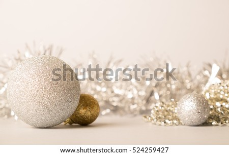 Big golden and small golden balls on golden background. Christmas and new year card