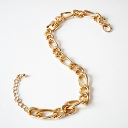 big golden chain on white background, pawnshop concept, jewerly shop concept