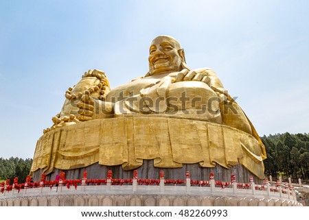 Big golden statue of Buddha in Qianfo Shan, also called mountain of the one thousand buddha, Jinan, Shandong Province, China #482260993