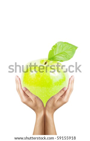 big green apple in hands isolated on white