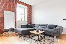 Big grey corner sofa in contemporary apartment