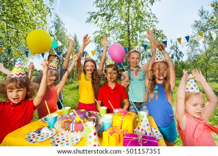 Big group of children at outdoor birthday party #501157351