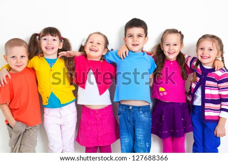 Big  group of diverse children  at  white wall