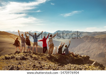 Big group of happy friends or tourists are having fun in mountains #1470976904