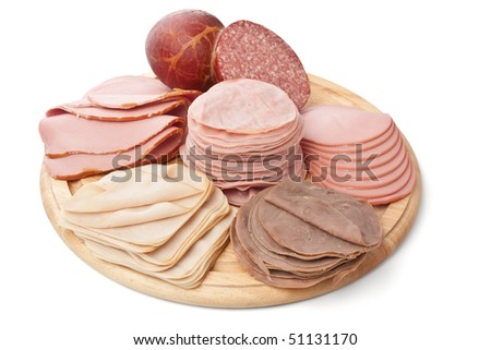 big group of meat on a round wooden board