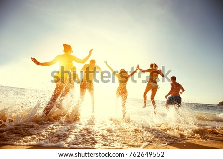 Big group of people having fun at sunset beach #762649552