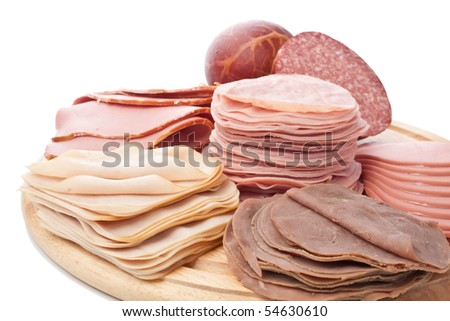 Big Group of Wafer Thin Sliced Meat Isolated on White Background