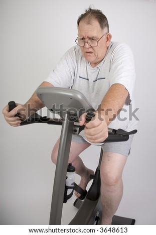 Big Guy Working Out On An Exercise Bike Stock Photo ...