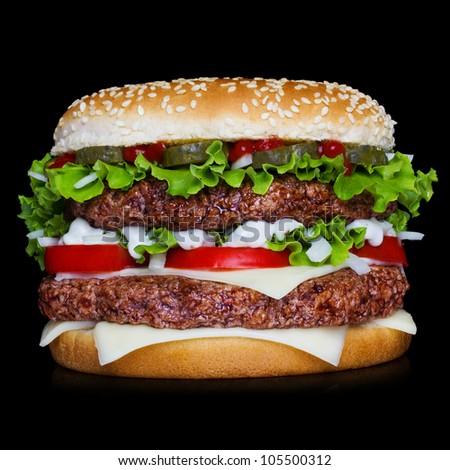 Big hamburger isolated on black background with reflection